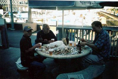 Ed, Founder of Quality Sea Food Pete Dragich and Nick sit for a post dive seafood meal.
