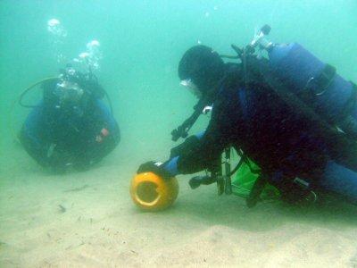 An underwater pumpkin carver.