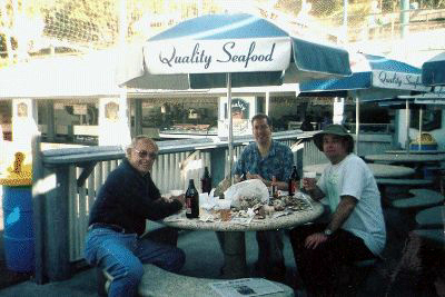 Pete Dragich, Nick and Me finish up.  Beer washes the ocean water out of our mouths!