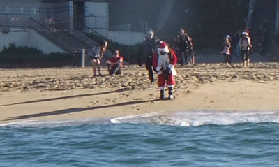 Santa enters the water.