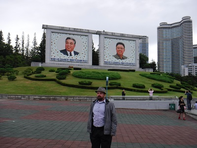 Me with huge portraits of their Dear Leaders.