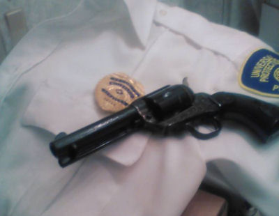 Badge and Gun.