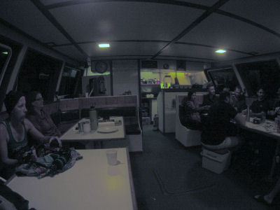 Divers relax on the Pacific Star after a long day of diving.