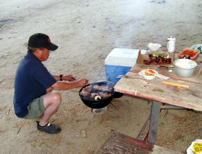 Ed cooks dinner.