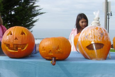 From left to right, a traditionally carved pumpkin, my pumpkin and TwinDuct's 'drowned pumpkin.'