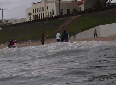 Just another day in Los Angeles... Santa Claus emerges from the ocean.
