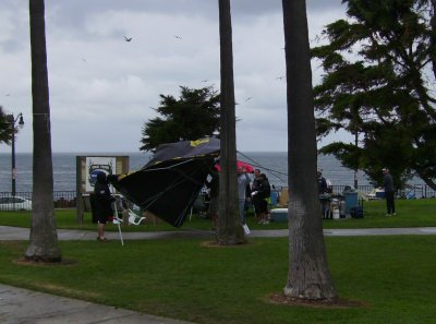 A gust of wind blows over one of the tents.