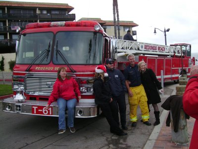 The Fire Department stops to pick up the donated toys.