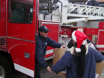 A fireman accepts the donated toys.