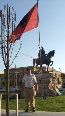 Me with the Albanian flag and the statue of their national hero.