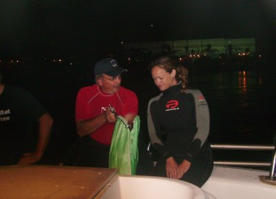 Dan instructs Donna on the proper bagging procedures.