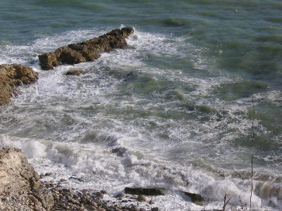 The waves pounded the cove, turning the sea into a brown mud.