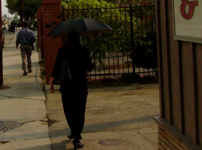 It was raining soot so bad, some residents opted for protection under umbrellas.