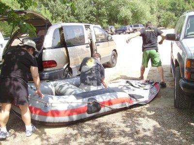John inflates the raft.
