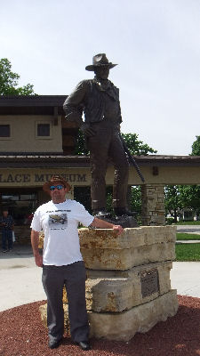 Me and a statue of John Wayne