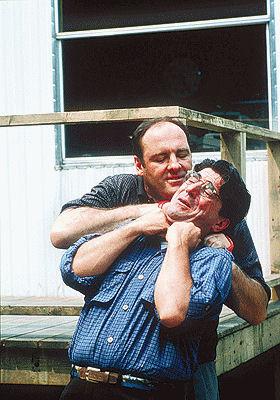 Tony Soprano chokes a victim.