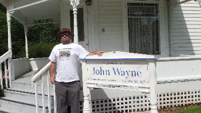 Me outside John Wayne's Birth Place