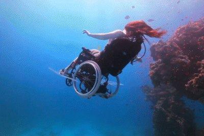 Underwater wheelchair SCUBA dive.